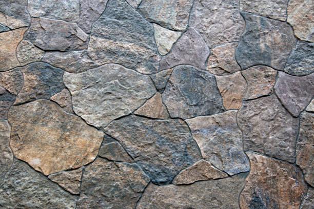 doğa taş arka plan - taş i̇nşaat malzemesi stok fotoğraflar ve resimler