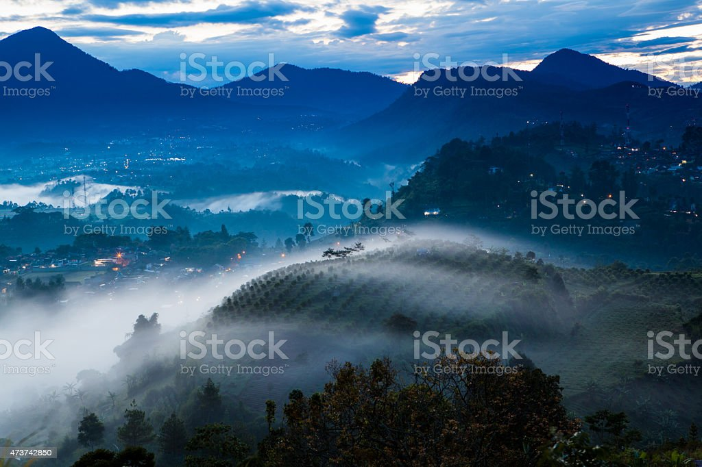 Nature sunrise landscape, fog and mist stock photo