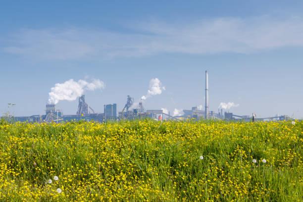 Nature versus industry (centered horizon version) stock photo