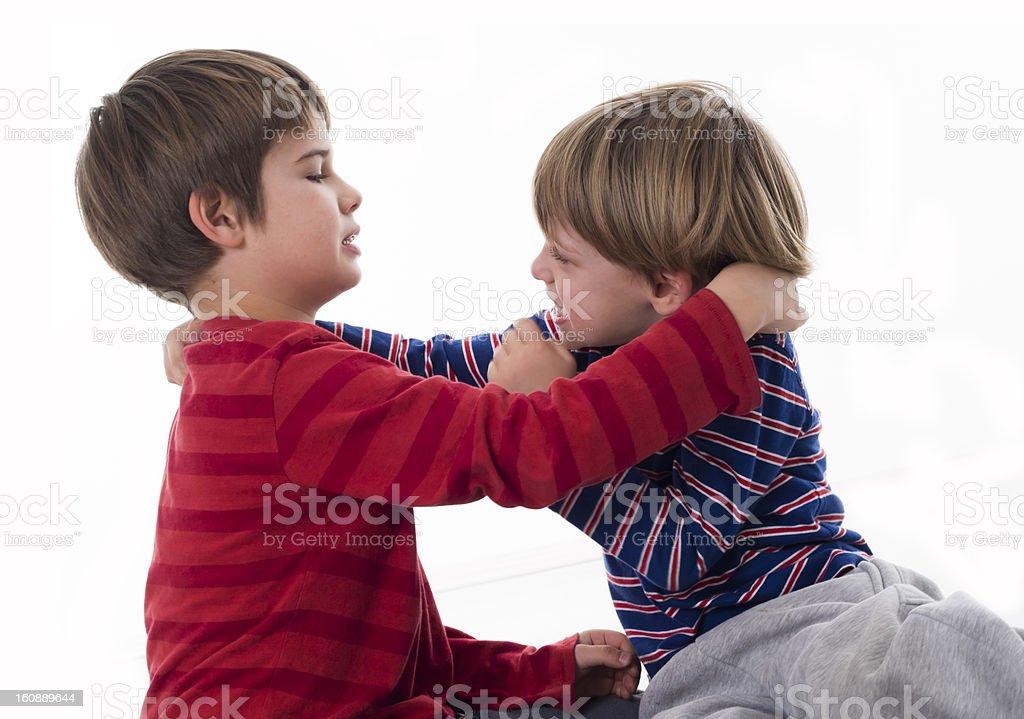 naughty boys fighting stock photo