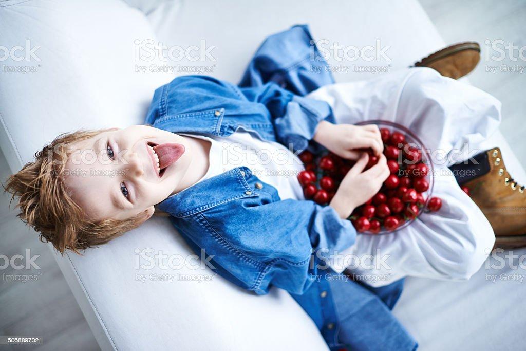 Naughty cherry lover stock photo