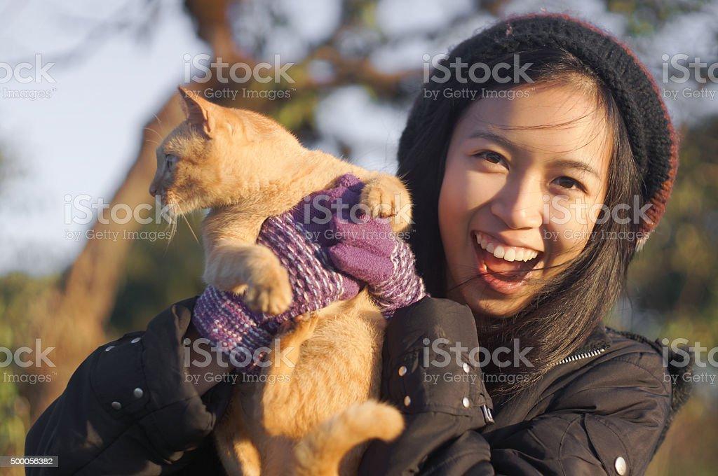 naughty girl catch naughty cat stock photo