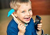 Naughtly little boy just broke daddy's smartphone.