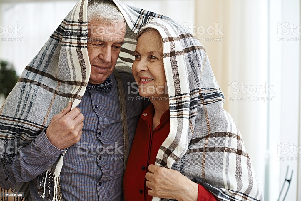 Naughty seniors stock photo