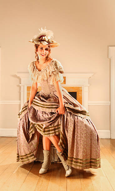 naughty victorian lady lifts skirts - petticoat stock pictures, royalty-free photos & images