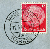 Naumburg, Kassel, Germany - March 12 1940: German historical stamp: Paul von Hindenburg on a blue postal envelope with  black ink cancellation, Germany, the Third Reich