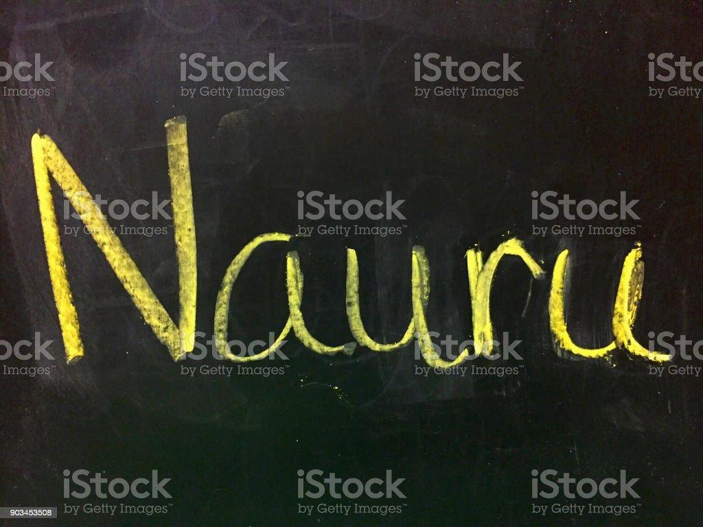 Nauru handwritten in chalk on a blackboard stock photo
