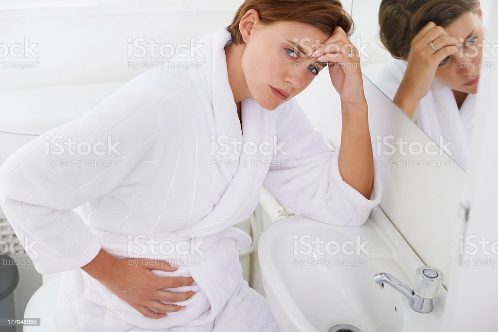 Nausea getting the best of her royalty-free stock photo