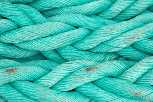 nautical background. old blue frayed ship rope closeup. - durabilidade imagens e fotografias de stock