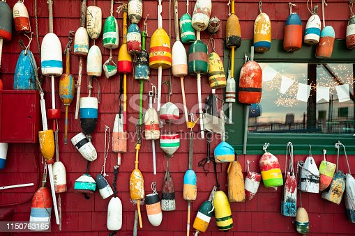 Bright coloured buoys hanging on a wooden fishing shack in Boston Massachusetts USA