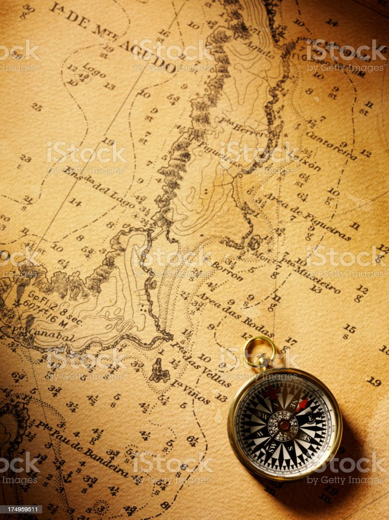 Nautical Chart and a Brass Compass stock photo