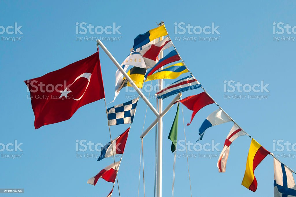 Nautical flags waving on the sky stock photo