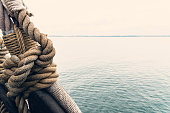 Nautical knot of rope in front of the sea