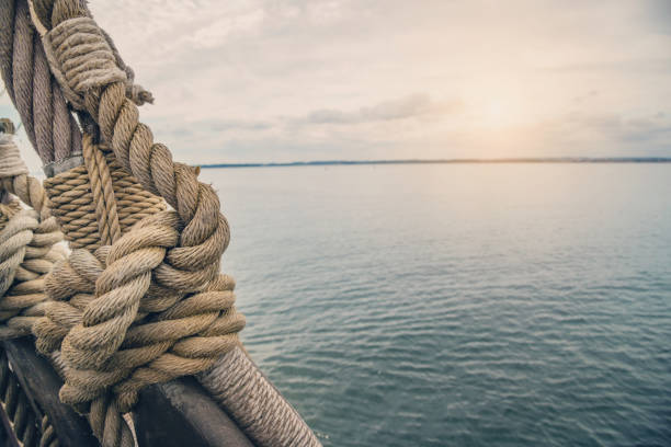 Nautical knot of rope in front of the sea stock photo
