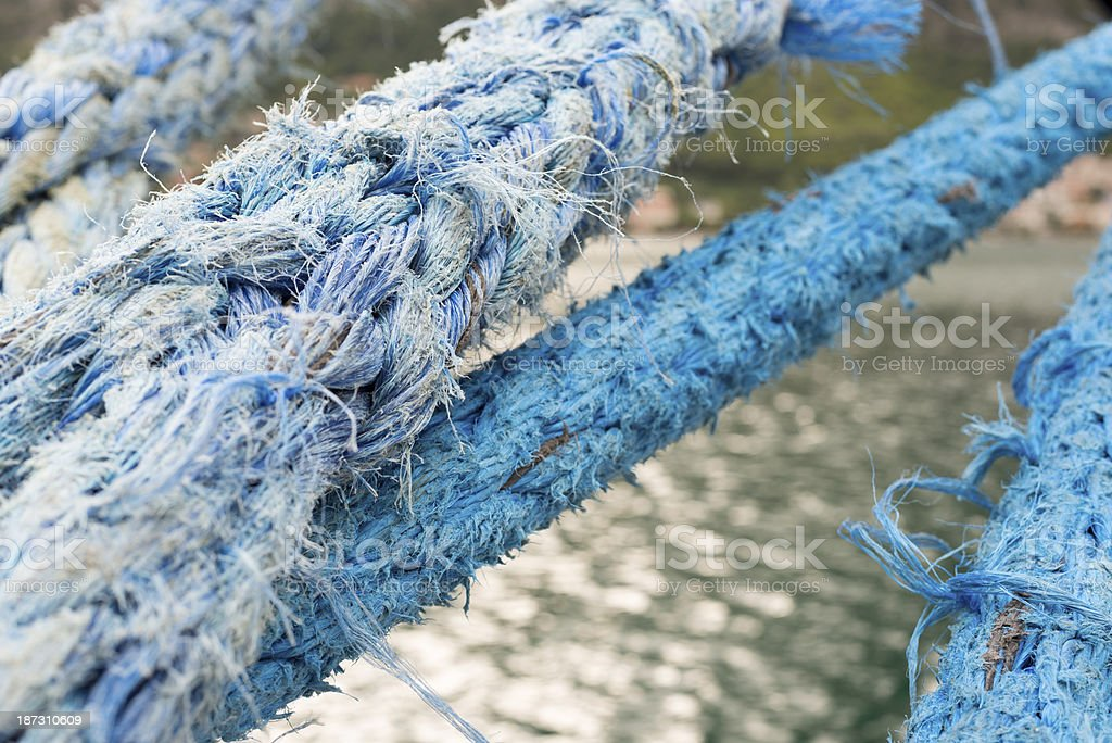 Nautical ship rope tied to dock royalty-free stock photo
