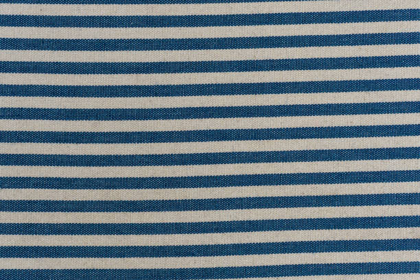 Nautical textile texture for background. Close up of a marine textile texture with blue and white stripes. stock photo