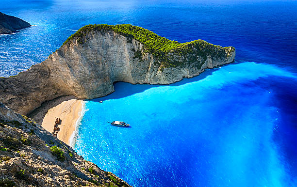 Navagio Beach (Shipwreck Beach), Zakynthos island, Greece. ProPhoto RGB. Famous Navagio beach (Smugglers Cove) with abandoned smuggler ship. Zakynthos island, Greece. ProPhoto RGB color space. mediterranean sea stock pictures, royalty-free photos & images