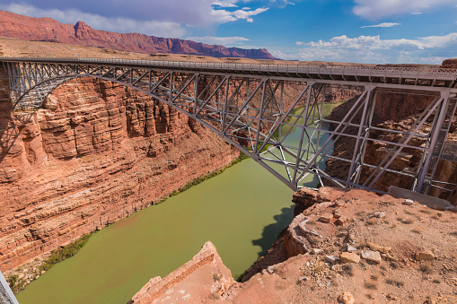 Navajo Bridge is a pair of steel spandrel arch bridges that cross the Colorado River near Lee's Ferry in northern Arizona. The newer bridge of the pair carries vehicular traffic on U.S. Route 89A (US 89A) over Marble Canyon between southern Utah and the Arizona Strip, allowing travel into a remote region north of the Colorado River including the North Rim of Grand Canyon National Park. Navajo Bridge steel spandrel arch bridges.