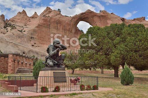 The memorial to the Navajo Code Talkers from world war II is in the back in the window rock, AZ city park with the Window Rock formation in the background
