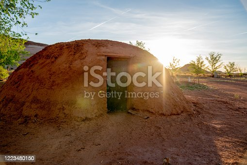 A Navajo family hogan at sunset, where they gather for family meals and family time