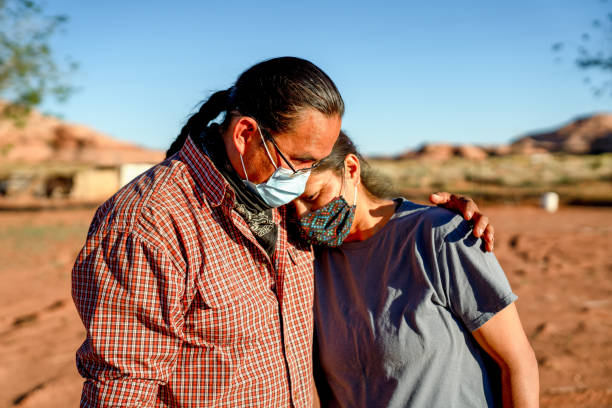 A Navajo Husband Comforts His Wife Because Of Lost Jobs And Income, Covid19 Shutdown stock photo