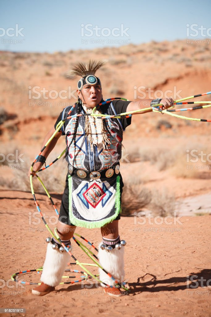A Navajo Native American Man performs traditional hoop dance stock photo