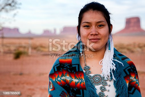 Pretty and Cheerful Native American Indian Teenage girl in an outdoor closeup environmental portrait