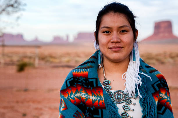 Navajo Native American Teenage Girl Outdoor Portrait Pretty and Cheerful Native American Indian Teenage girl in an outdoor closeup environmental portrait indigenous peoples of the americas stock pictures, royalty-free photos & images