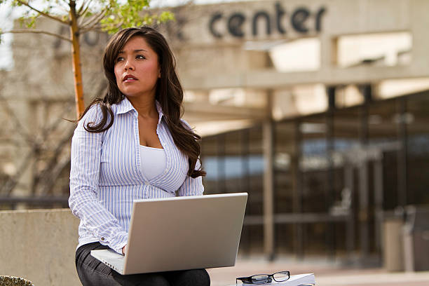 Navajo student at school with laptop stock photo