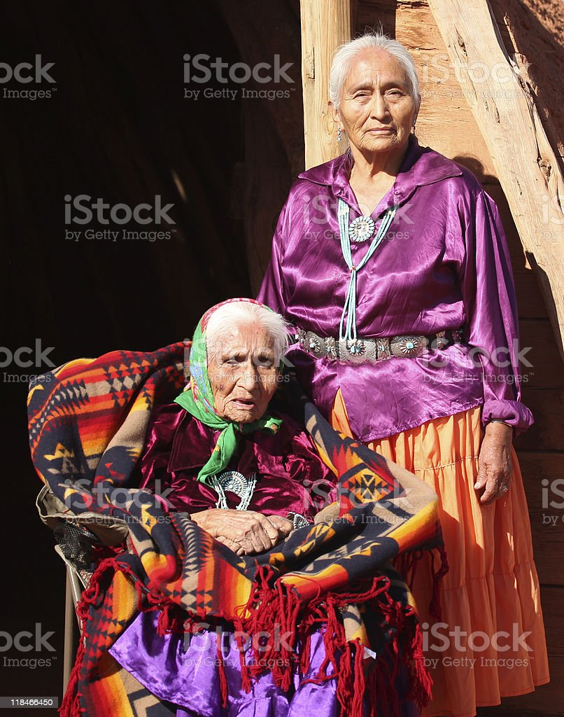 Navajo Women in Traditional Clothing Who Are Mother and Daughter  stock photo