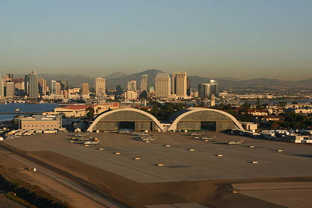 Naval Air Station North Island Hangars These two hangars are historical landmarks in San Diego. The were built in World War Two for seaplanes. San Diego is in the background.  military base stock pictures, royalty-free photos & images