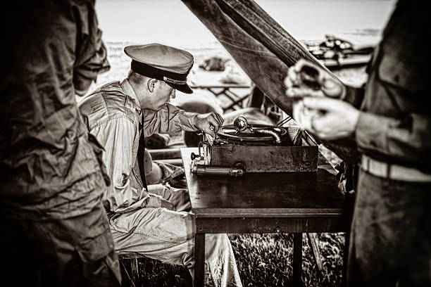 naval officer enjoying the music on his vintage phonograph - world war ii stock photos and pictures