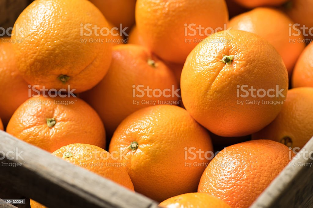 Navel Oranges in a Wooden Crate royalty-free stock photo