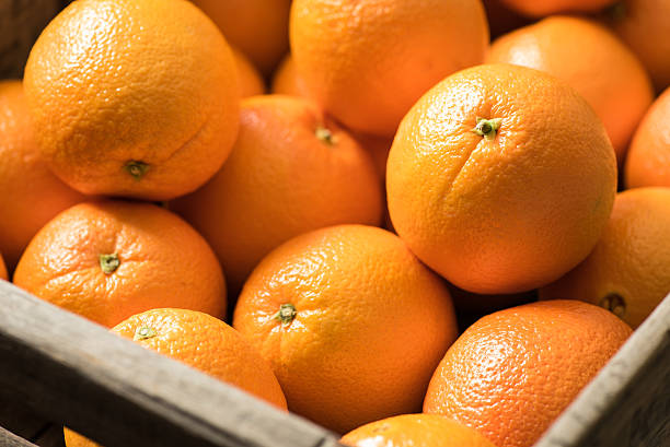 Navel Oranges in a Wooden Crate stock photo