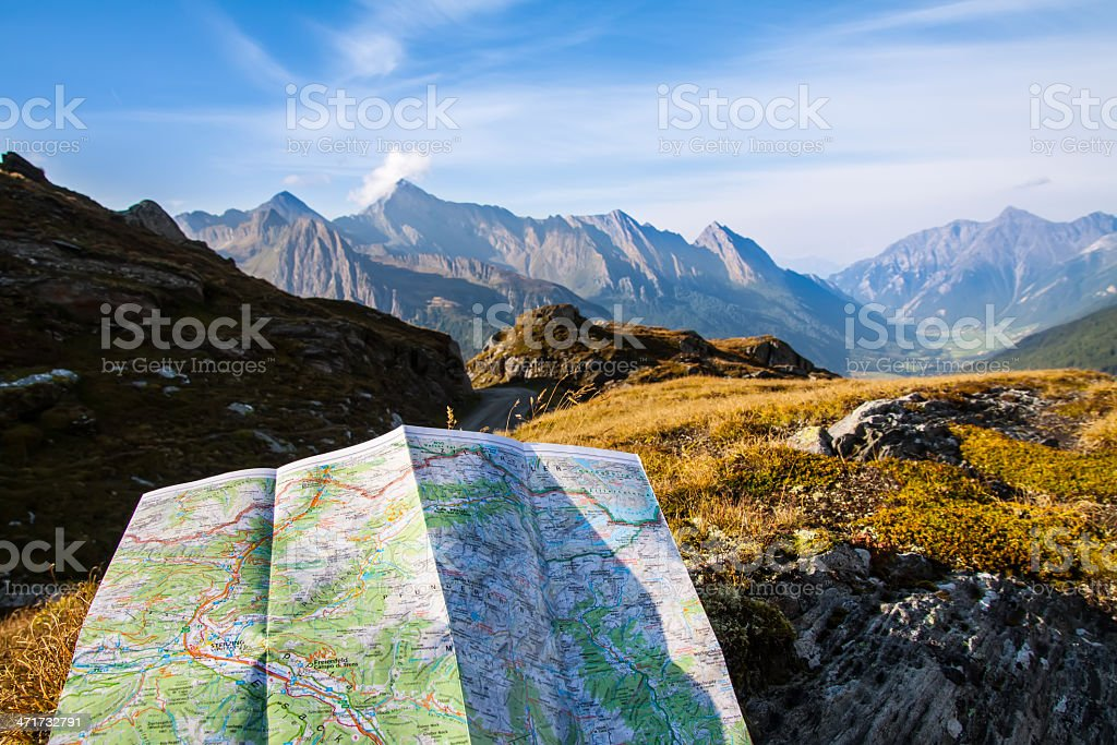 Navigate with map in the mountain royalty-free stock photo