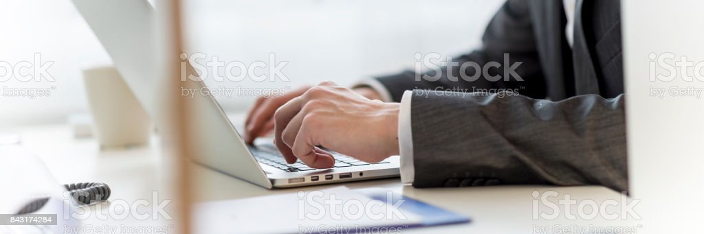 Navigating the internet on laptop computer stock photo