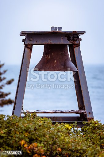 A navigation bell at Bass Harbor Lighthouse atop a cliff near the entrance to Bass Harbor, Maine