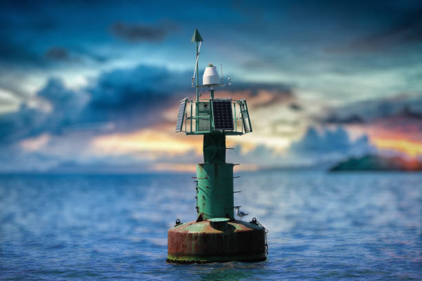 Navigation Buoy with Solar Panels A buoy on sea and a sea bird on the buoy buoy stock pictures, royalty-free photos & images