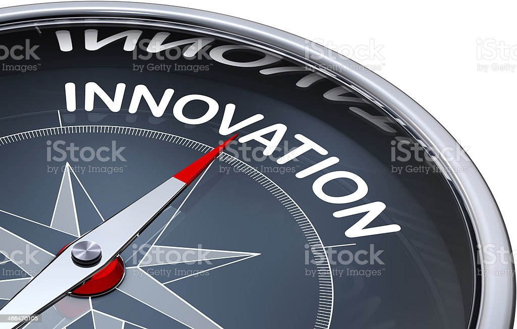 Navigation compass with needle pointing to innovation text stock photo