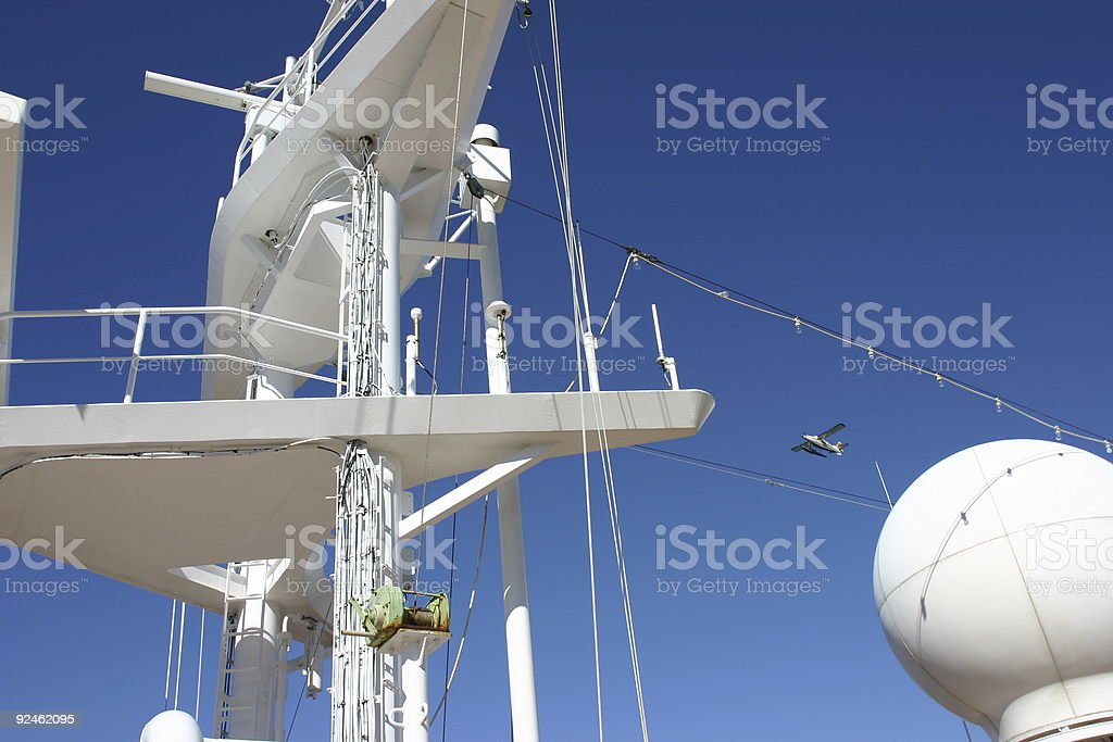 Navigation mast  with plane flying over royalty-free stock photo