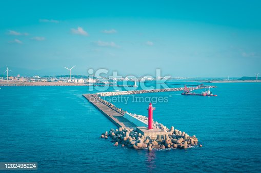 istock Navigation Ocean light house in  Takamatsu Bay, Japan. while the sun is setting. For Navigation and guiding concept. 1202498224