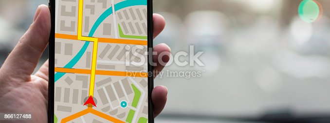 istock GPS Navigation on Mobile Phone Device and Transportation Concept. Male Hand Using Navigation System Map Tracking on Smartphone with Copy Space. 866127488