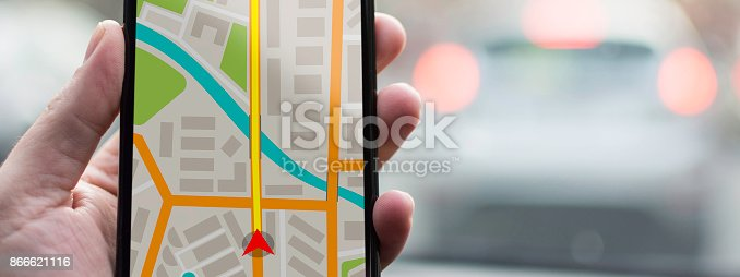 istock GPS Navigation on Mobile Phone Device and Transportation Concept. Male Hand Using Navigation System Map Tracking on Smartphone with Copy Space. 866621116