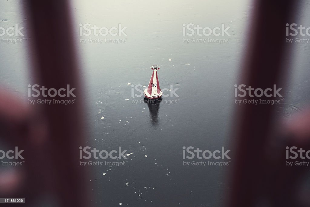 Navigational Buoy in winter morning. royalty-free stock photo