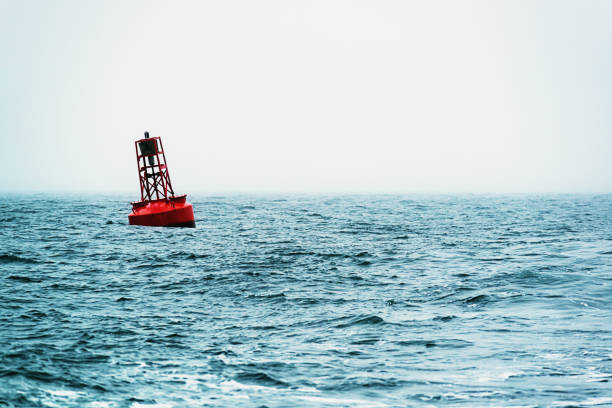 Navigational Buoy An offshore navigational buoy in the Atlantic. buoy stock pictures, royalty-free photos & images