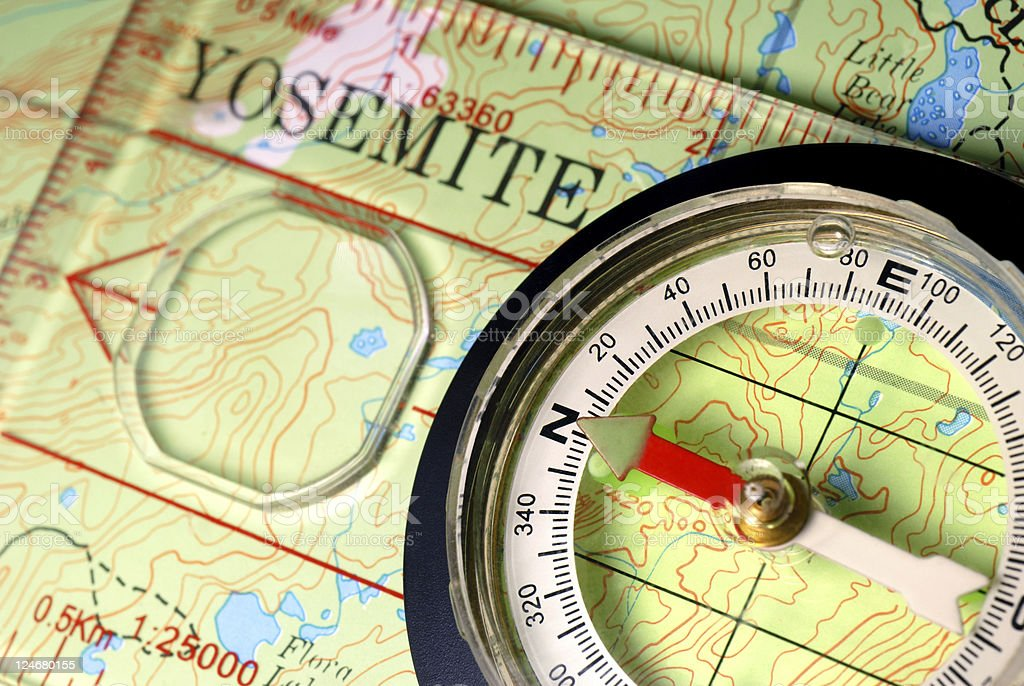 Navigational Compass on Topographical Map royalty-free stock photo