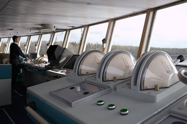 Navigational officer driving ship on the river. stock photo