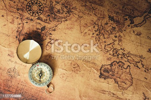 istock Navigator explore journey with compass and world map., Travel destination and planning vacation trip., Vintage concept. 1127204666