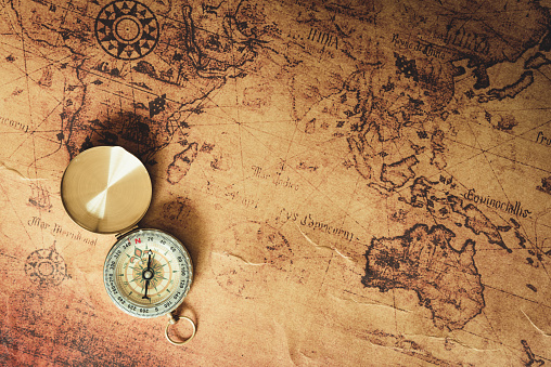 Navigator explore journey with compass and world map., Travel destination and planning vacation trip., Vintage concept.