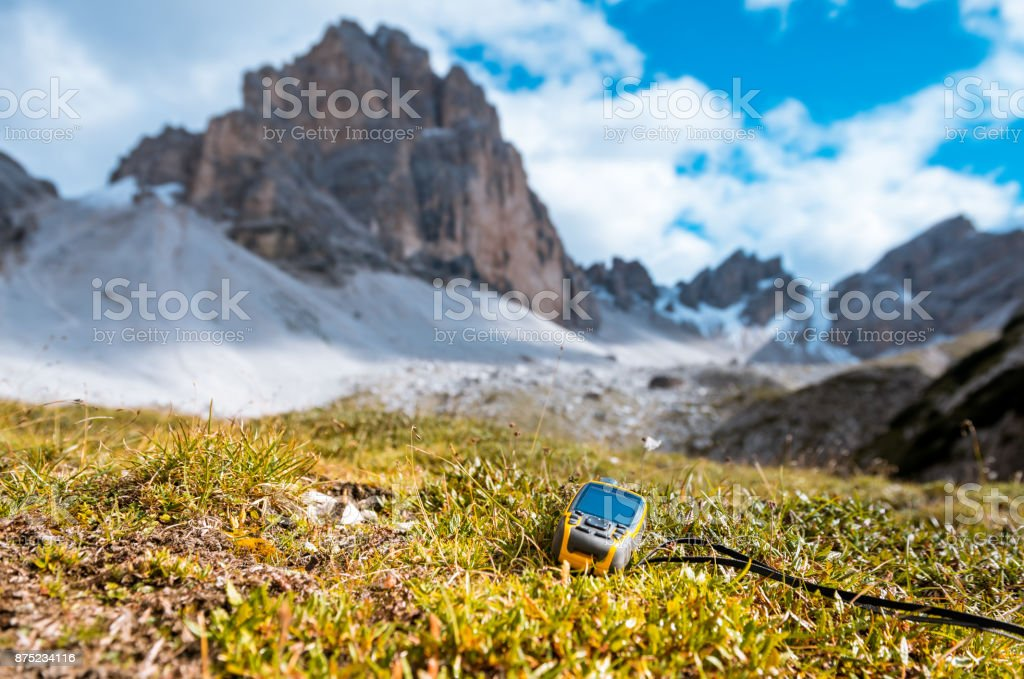 GPS navigator in hand Dolomites Alps stock photo